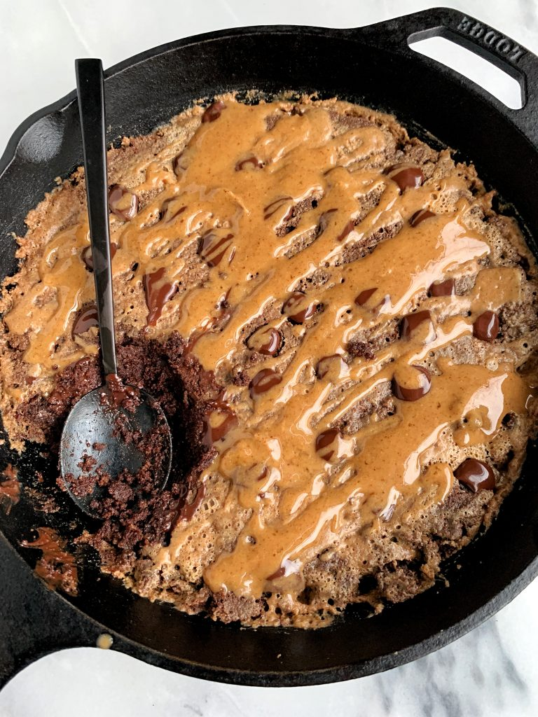 This Paleo Salted Caramel Brownie Skillet is the best most fudgey chocolatey brownie recipe ever. Plus it is lower in sugar and is made with all gluten-free, dairy-free and refined sugar-free ingredients.