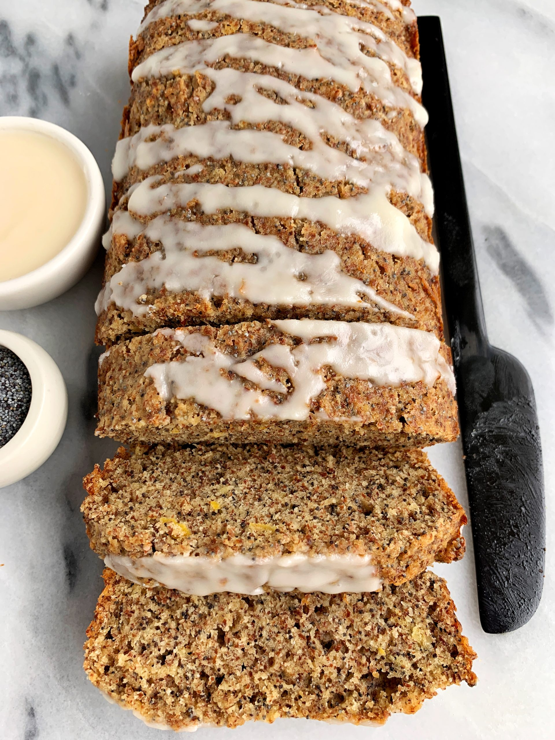 The Best Paleo Lemon Poppyseed Bread made with all gluten-free and dairy-free ingredients. Sweetened with maple syrup and glazed with a little coconut butter on top.