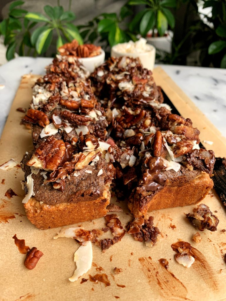 The Most Magical Magic Cookie Bars made with all vegan and paleo ingredients. A healthier twist on magic cookie bars with a doughy cookie base and pecan, chocolate and coconut topping!