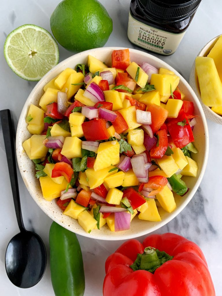 The Best Summery Mango Salsa made with all fresh and healthy ingredients like mango, red pepper and a little sweetness from organic manuka honey.