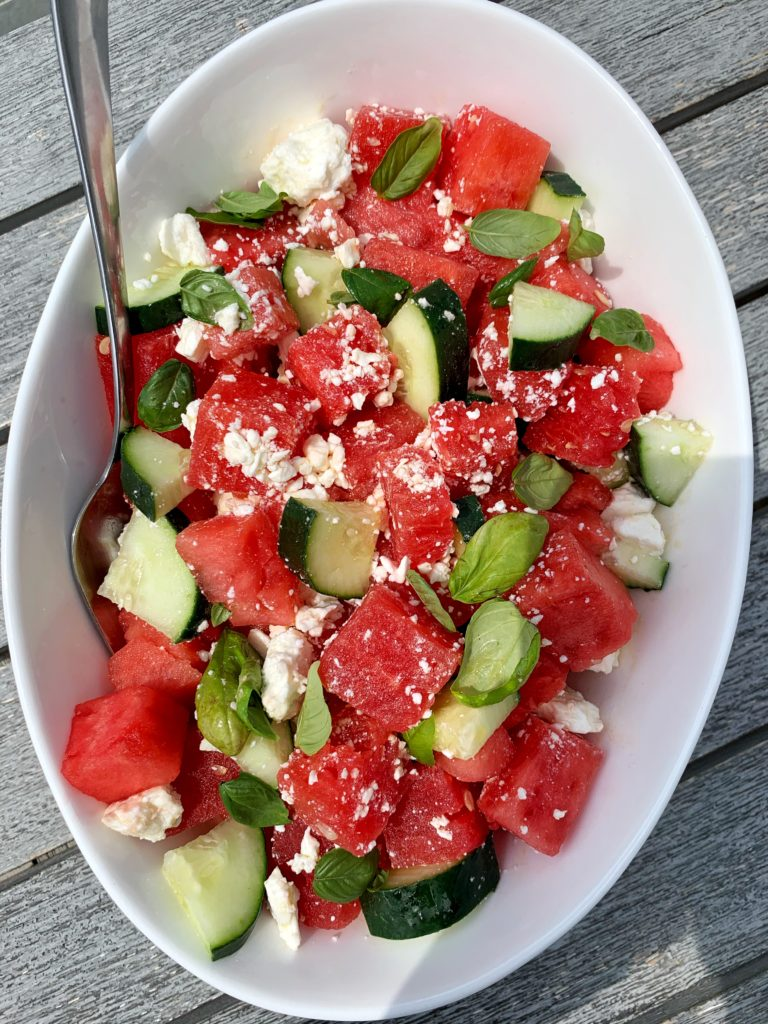 Sharing the most summery summertime salad: this Watermelon Salad with Feta, Cucumber + Basil. Take 5 minutes to prep and is incredibly refreshing, delicious and a healthy salad to serve all summer long.