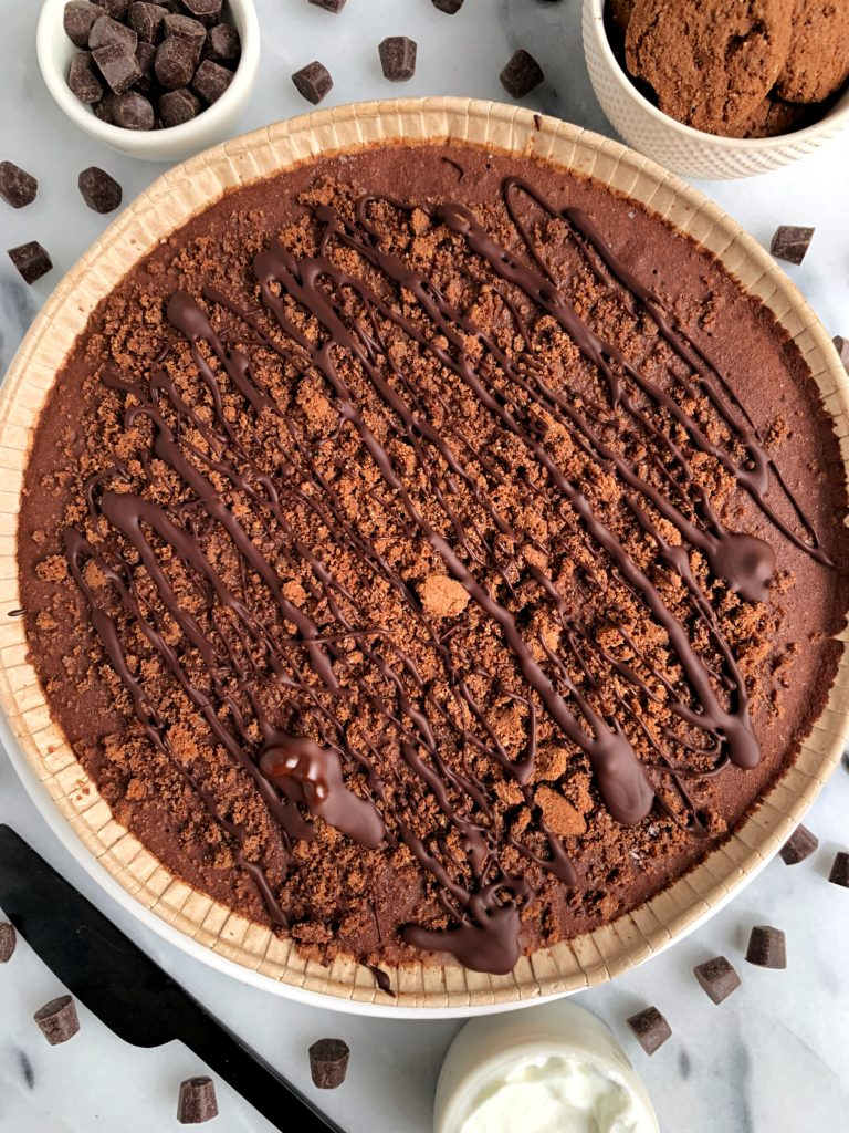Easy No-Bake Chocolate Cream Pie with a gluten-free grain-free chocolate crust that tastes like oreos. Filled with a delicious 3-ingredient chocolate cream. No cashews or tofu needed! Just the right amount of richness and chocolatey flavor and pairs perfectly with a dollop of ice cream on top!