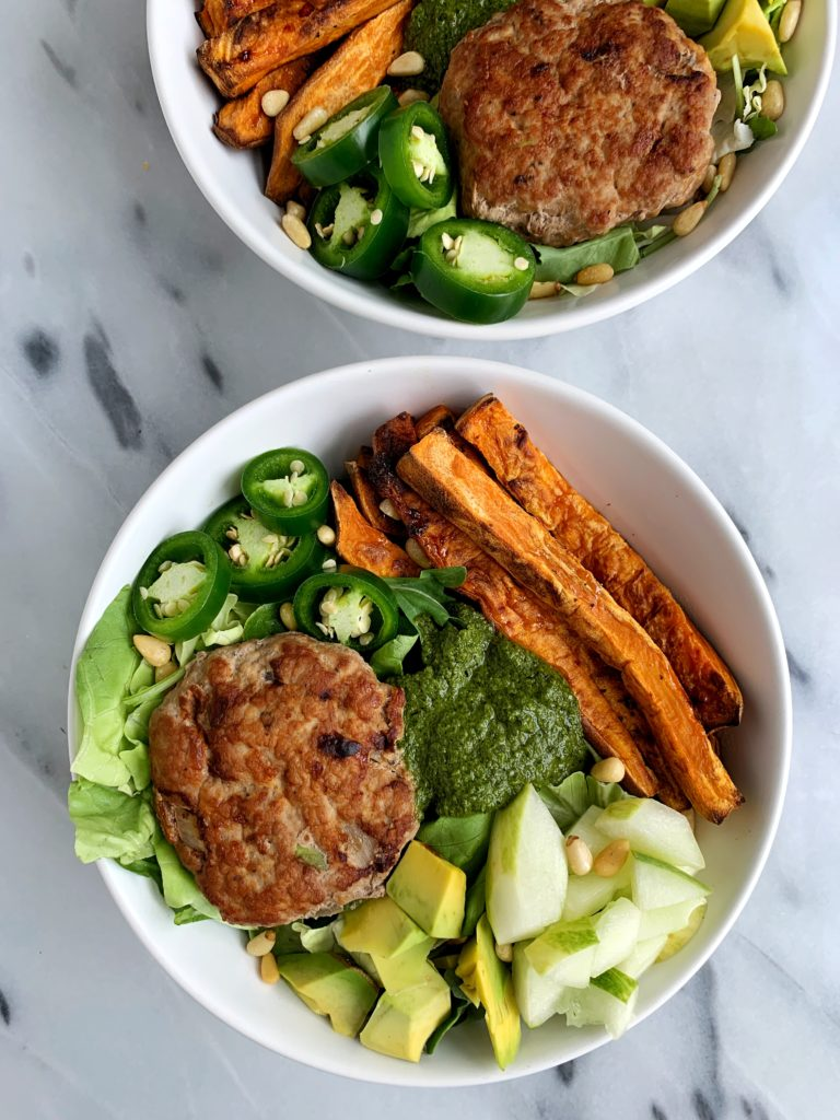 The juiciest healthy Avocado Chicken Burgers made with all paleo and whole30 ingredients. An easy and delicious chicken burger made on the stovetop (no grill needed) and paired with crispy sweet potato fries and topped with anything you are craving.