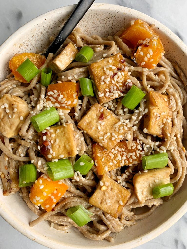 Sharing my latest vegan meal idea: Healthy Chili Peanut Noodles with Crispy Sesame Tofu today on the blog! An easy and delicious gluten-free dish that is so flavorful and tasty and filled with yummy crispy tofu.
