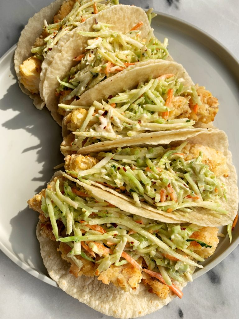 The Best Crispy Oven-Baked Paleo Fish Tacos made with all gluten-free ingredients and ready in less than 30 minutes start to finish. A family favorite over here that we all crave for dinner.