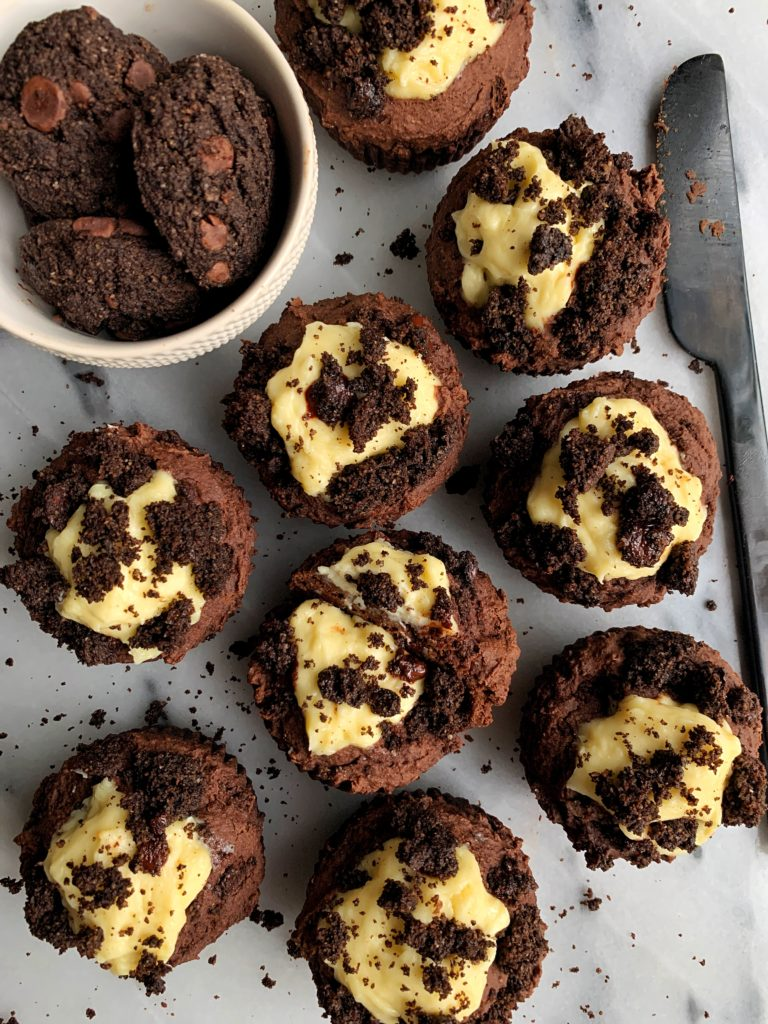 Vegan Double Chocolate Oreo Muffins made with all gluten-free and nut-free ingredients and filled with a delicious dairy-free cream cheese filling and topped with crushed double chocolate chips cookies.