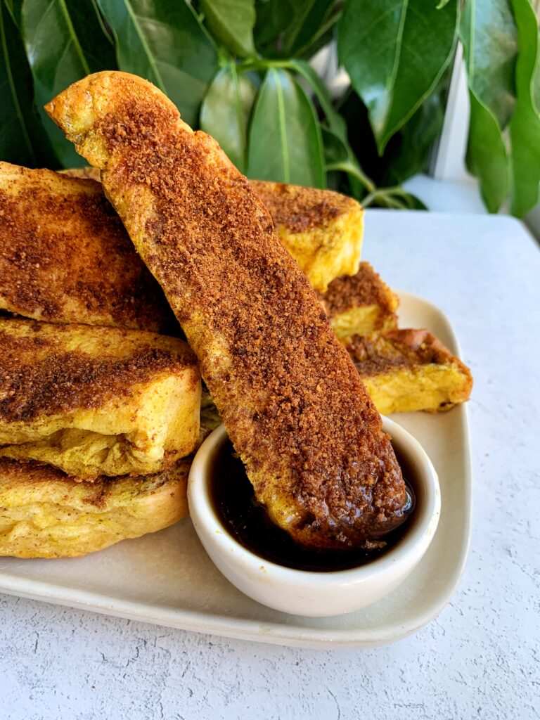 The BEST Cinnamon Sugar Challah French Toast Sticks! These are the ultimate breakfast or brunch recipe to make when you are craving french toast and they are made in the oven.