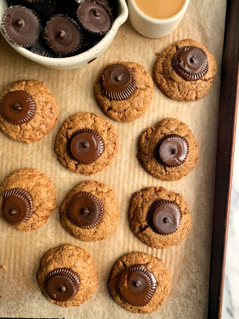 Gluten-free Peanut Butter Cup Blossoms that are truly the most delicious, soft-baked grain-free and vegan peanut butter cookie topped with dreamy dark chocolate peanut butter cups.