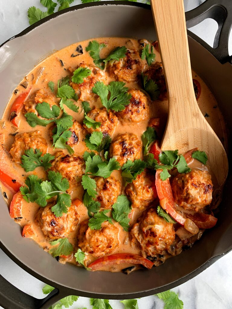 Healthy Thai Turkey Meatballs in Coconut Curry made with all gluten-free, dairy-free and paleo ingredients. This recipe is packed with flavor and can be served over your favorite rice, noodles, zucchini noodles, anything you want!