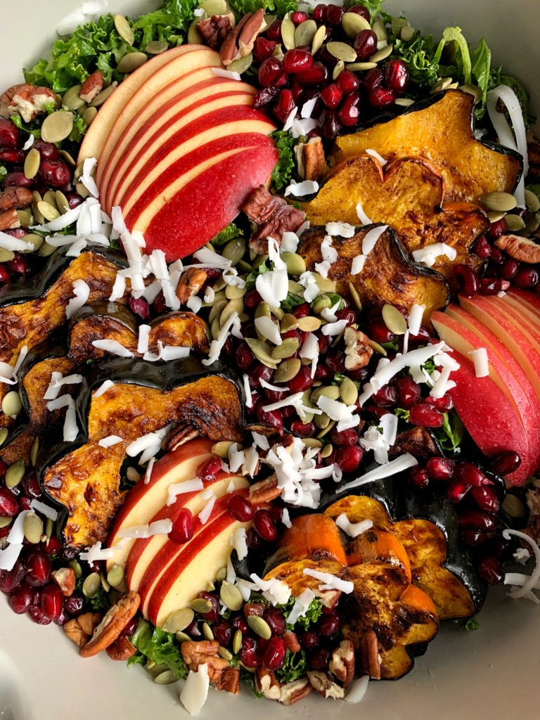 The Ultimate Healthy Harvest Salad made with all gluten-free and vegetarian ingredients. An absolutely delicious wholesome salad filled with roasted squash, fall fruits and a homemade pomegranate honey dressing.