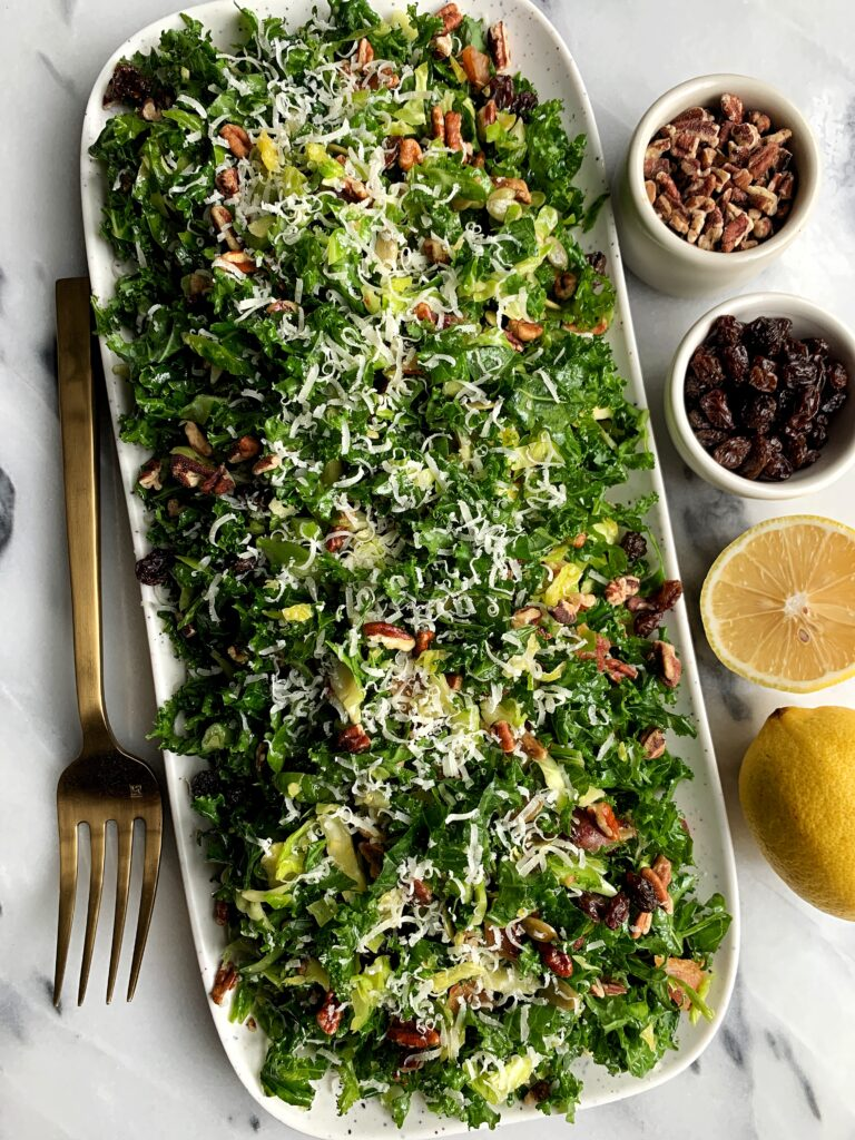 Healthy and delicious Kale + Brussels Sprout Slaw with a homemade Honey Mustard Dressing. One of my favorite quick and easy salads to whip up and it is made with all gluten-free ingredients.