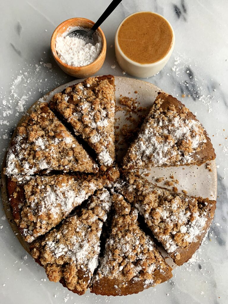 The most delicious Paleo Gingerbread Coffee Cake made with a dreamy gingerbread cake base and topped with a paleo crumb cake topping.
