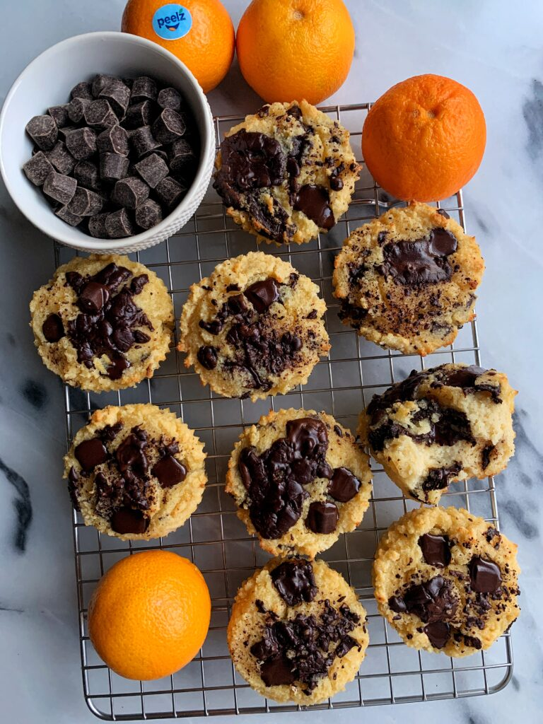 Paleo Mandarin Orange Chocolate Chip Muffins made with all gluten-free and dairy-free ingredients. These are the ultimate healthy muffin recipe with the best dark chocolate and mandarin orange flavor combination.