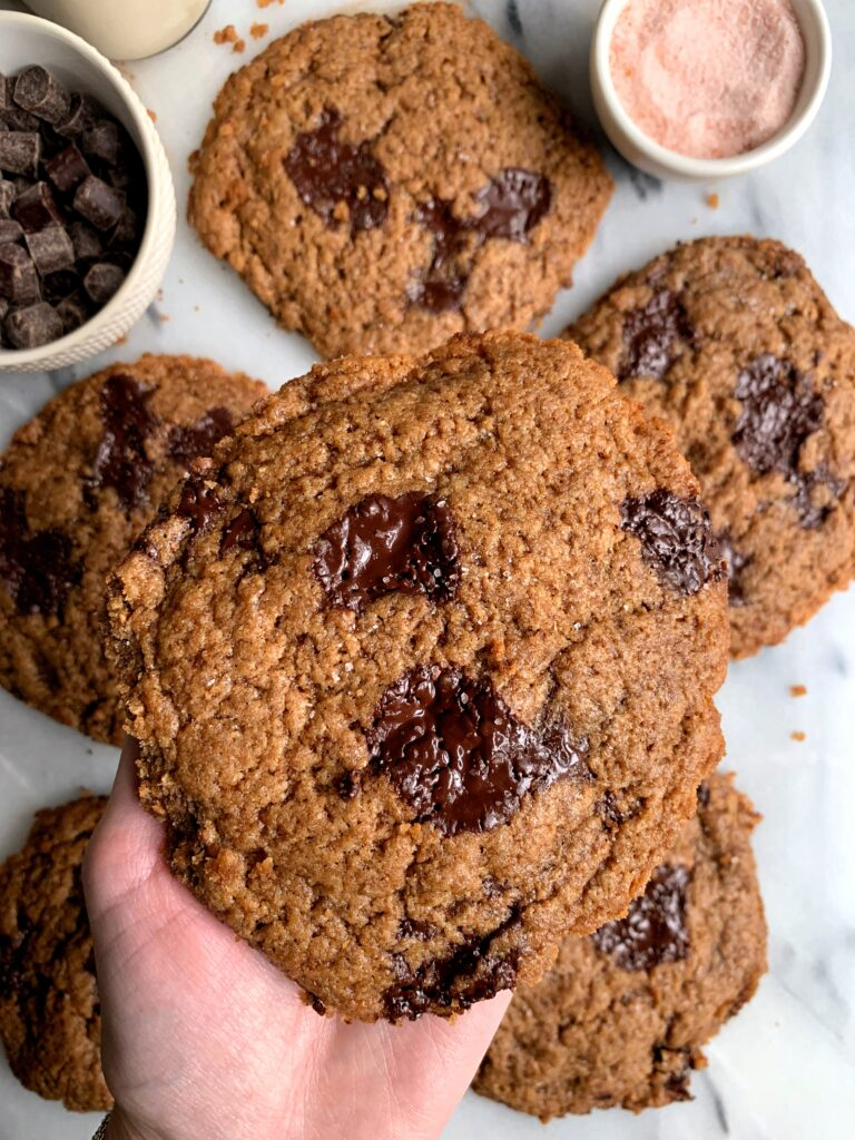 Healthier Bakery-Style Chocolate Chip Cookies made with all gluten-free and vegan ingredients. These taste just like the sea salt chocolate chip cookies from the local bakery and have the best soft gooey center.