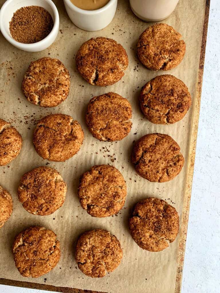 Gluten-free Peanut Butter Snickerdoodle Cookies made with all grain-free and dairy-free ingredients. These are the most delicious snickerdoodle with a hint of peanut butter and sweetened with coconut sugar and maple syrup.
