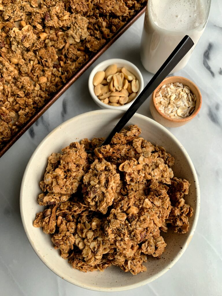 Addicting Gluten-free Cinnamon Peanut Butter Granola with big CLUSTERS! This vegan granola recipe is absolutely delicious and so easy to make.