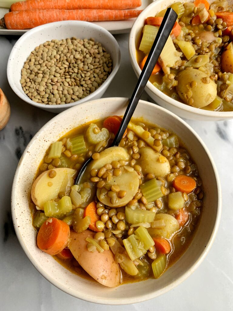 The Easiest Veggie-Loaded Lentil Soup made with all vegan and gluten-free ingredients! This is one of our go-to cozy meals that is so flavorful, easy to make and one of those freezer-friendly meals to keep on hand.