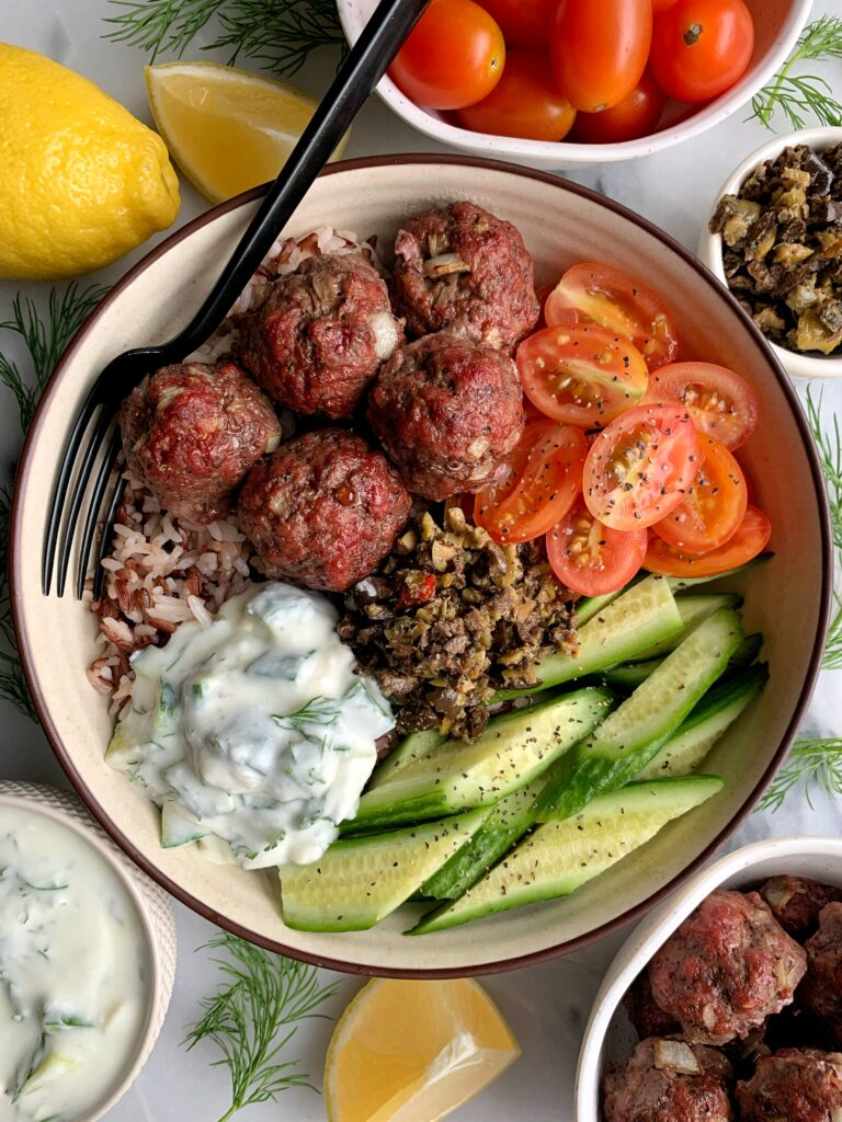 Sharing one of our favorite easy dinners, 30-minute Healthy Greek Meatballs with Tzatziki Sauce! The easiest oven-baked meatballs paired with homemade tzatziki for a delicious and healthy bowl idea.