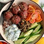 Sharing one of our favorite easy dinners, 30-minute Healthy Greek Meatballs with Tzatziki Sauce! The easiest oven-baked paleo meatballs.