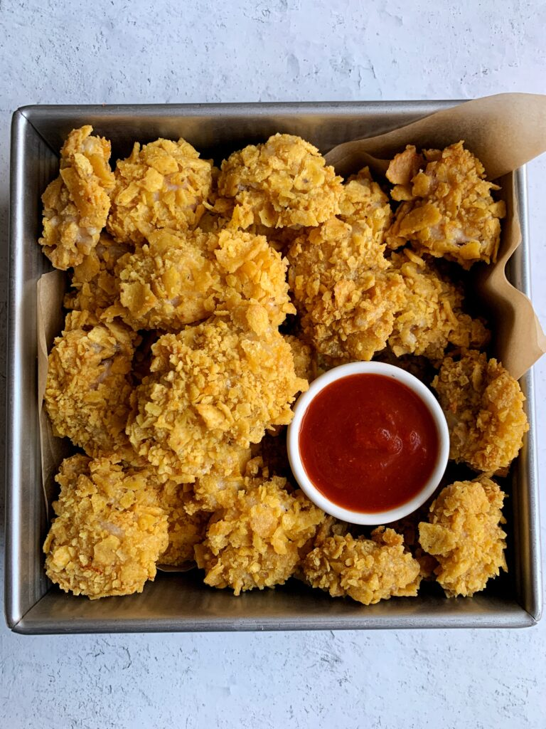 Extra Crispy Gluten-free Popcorn Chicken that is oven-baked and easy to make. A family favorite made with healthier ingredients!