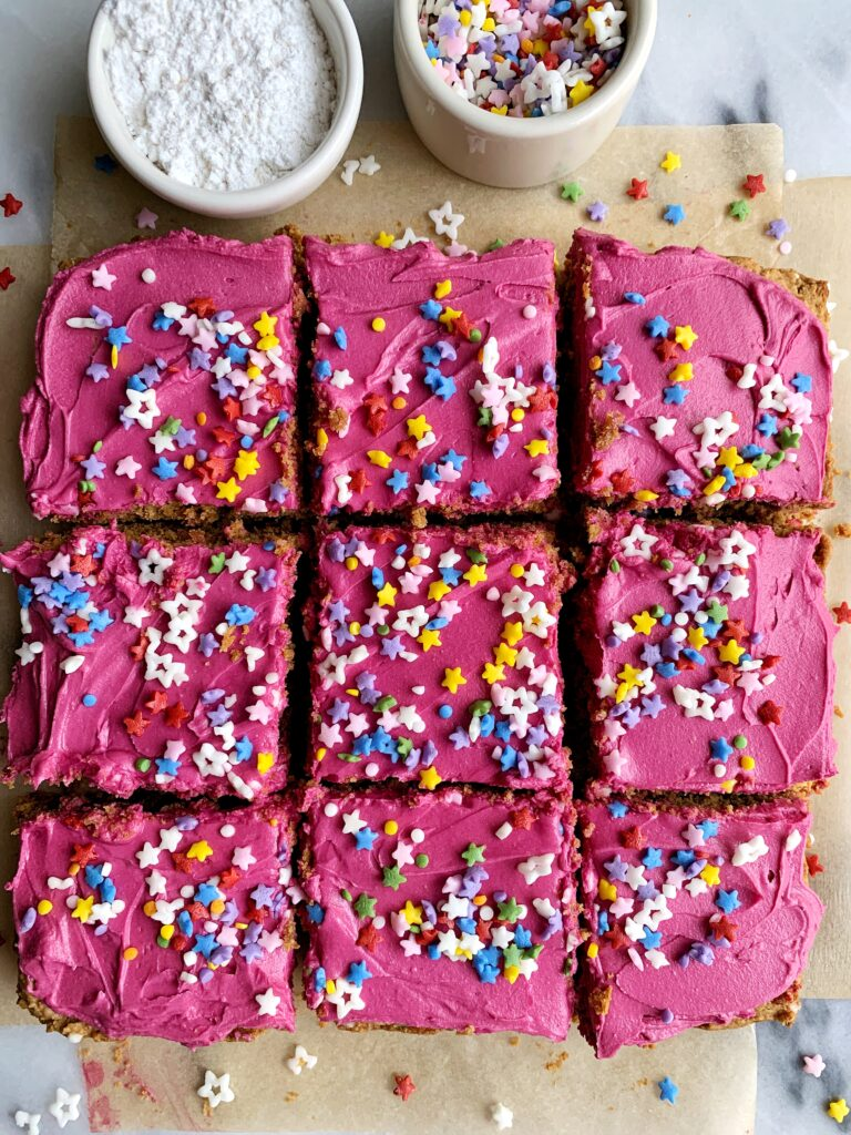 """The absolute best Vegan Sugar Cookie Bars made with all gluten-free and nut-free ingredients and topped with vanilla frosting, sprinkles and tastes almost too good to be true for a """"healthier"""" sugar cookie recipe."""