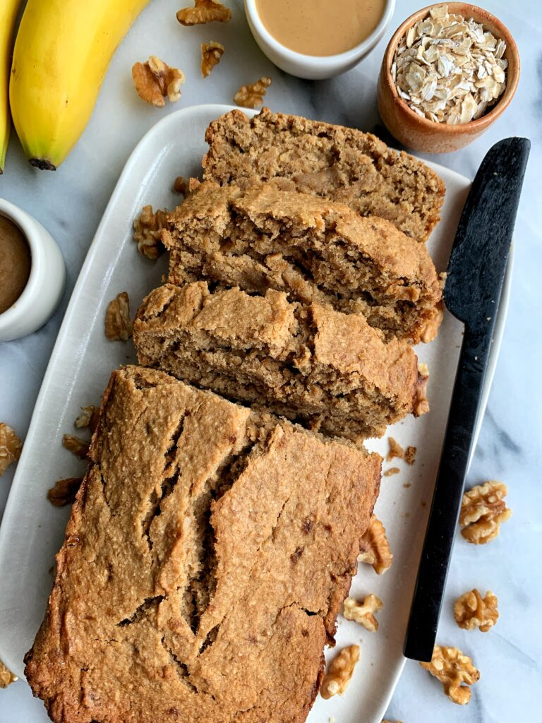 This Vegan Salted Caramel Banana Bread is the ultimate healthy gluten-free banana bread recipe. Filled with homemade salted caramel and some more drizzled on top!