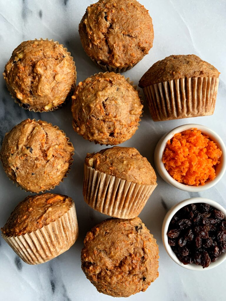 The Best Ever Vegan Morning Glory Muffins made with all gluten-free and dairy-free ingredients. Filled with carrots, raisins, walnuts and have that delicious muffin top and fluffy cakey muffin base.
