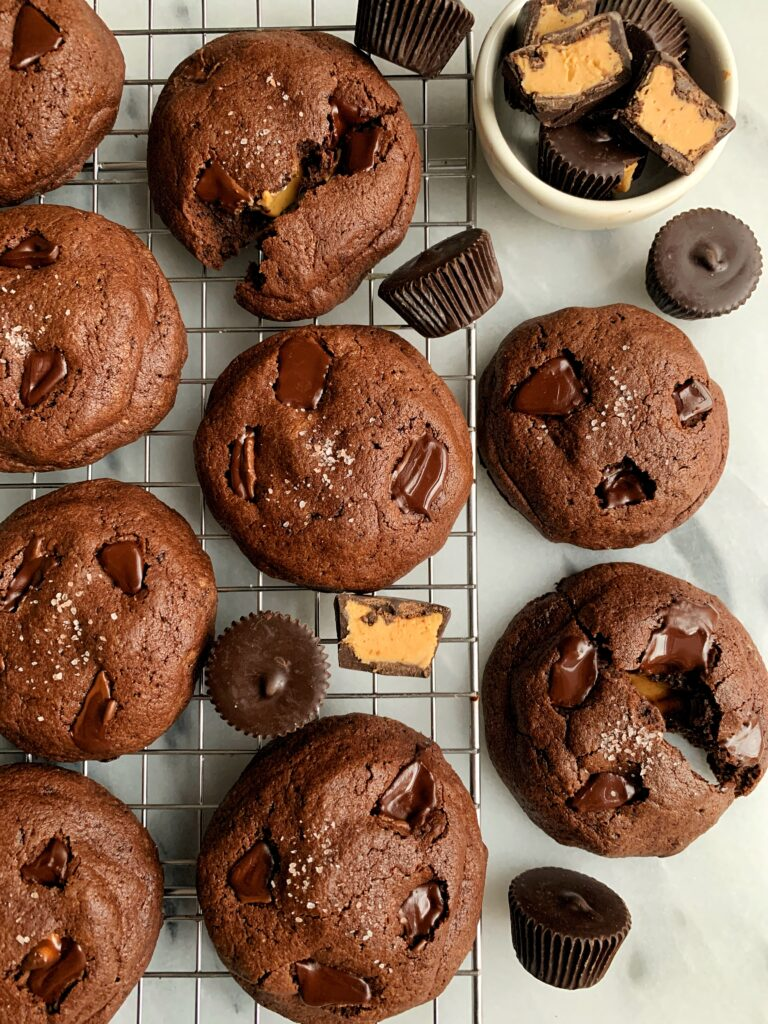 Life changing gluten-freePeanut Butter Cup Stuffed Brownie Cookies that are actually out of this world. Easy to make and each stuffed with a dark chocolate peanut butter cup.