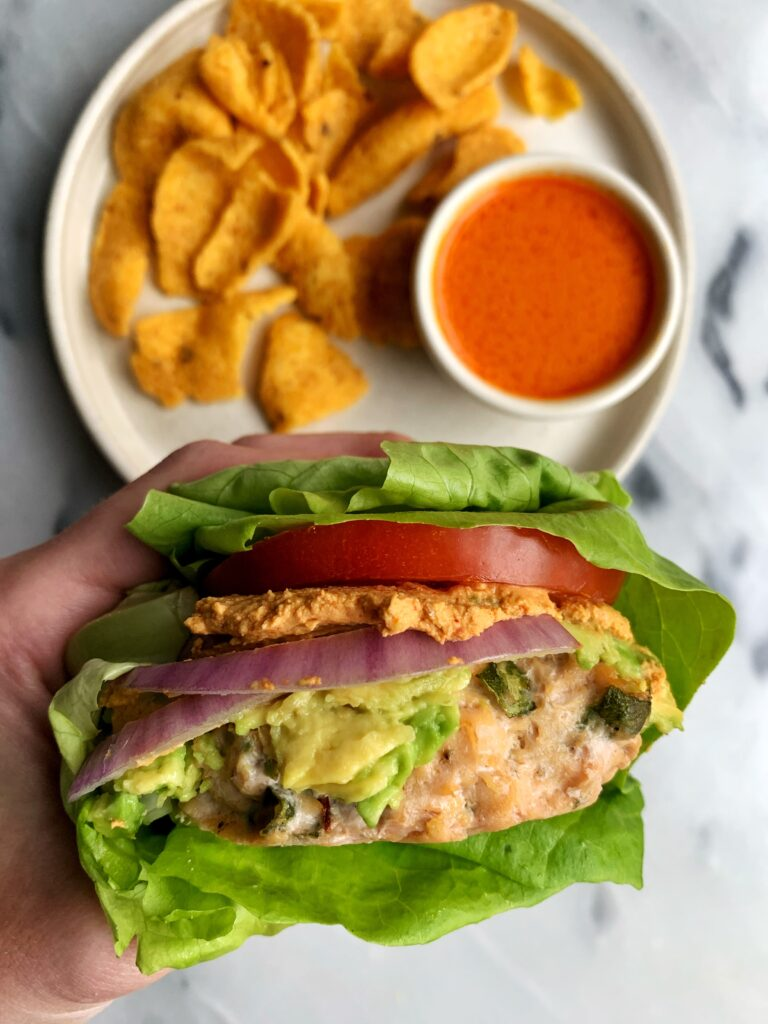 Epic healthy gluten-free Buffalo Chicken Burgers ready in 20 minutes. These are the easiest and tastiest chicken burgers made with all dairy-free and paleo ingredients. Plus they are Whole30 sans bun.