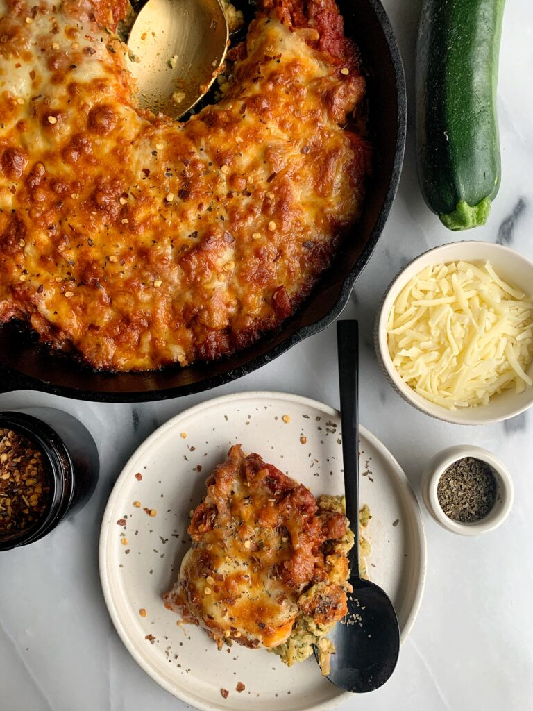 This healthy Zucchini Pizza Casserole is an easy and delicious dinner recipe for the whole family. Plus it is gluten-free, low-carb, grain-free and made with just a few ingredients!