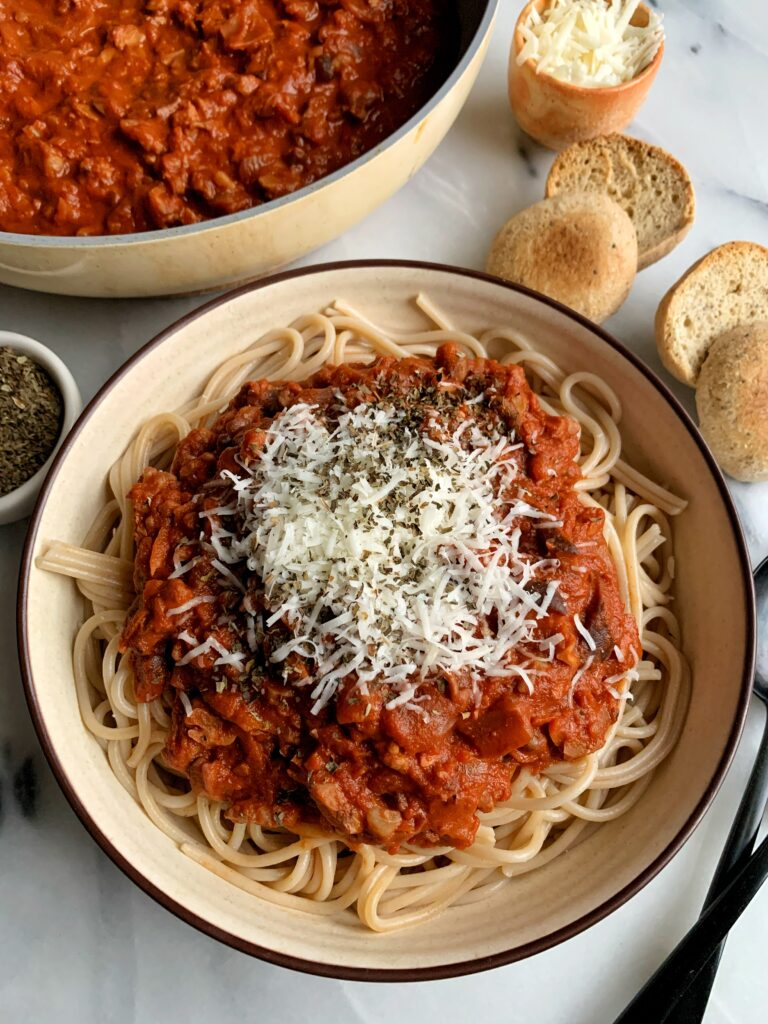 The best Vegan Bolognese Pasta recipe ever! This is the ultimate vegetarian bolognese pasta sauce that is gluten-free, super easy to make and so flavorful and delicious with your favorite pasta!
