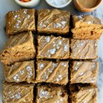 These Gluten-free Carrot Cake Cheesecake Bars are absolutely delicious. A carrot cake base made with all gluten and grain-free ingredients topped off with a cheesecake topping made with 3 ingredients!