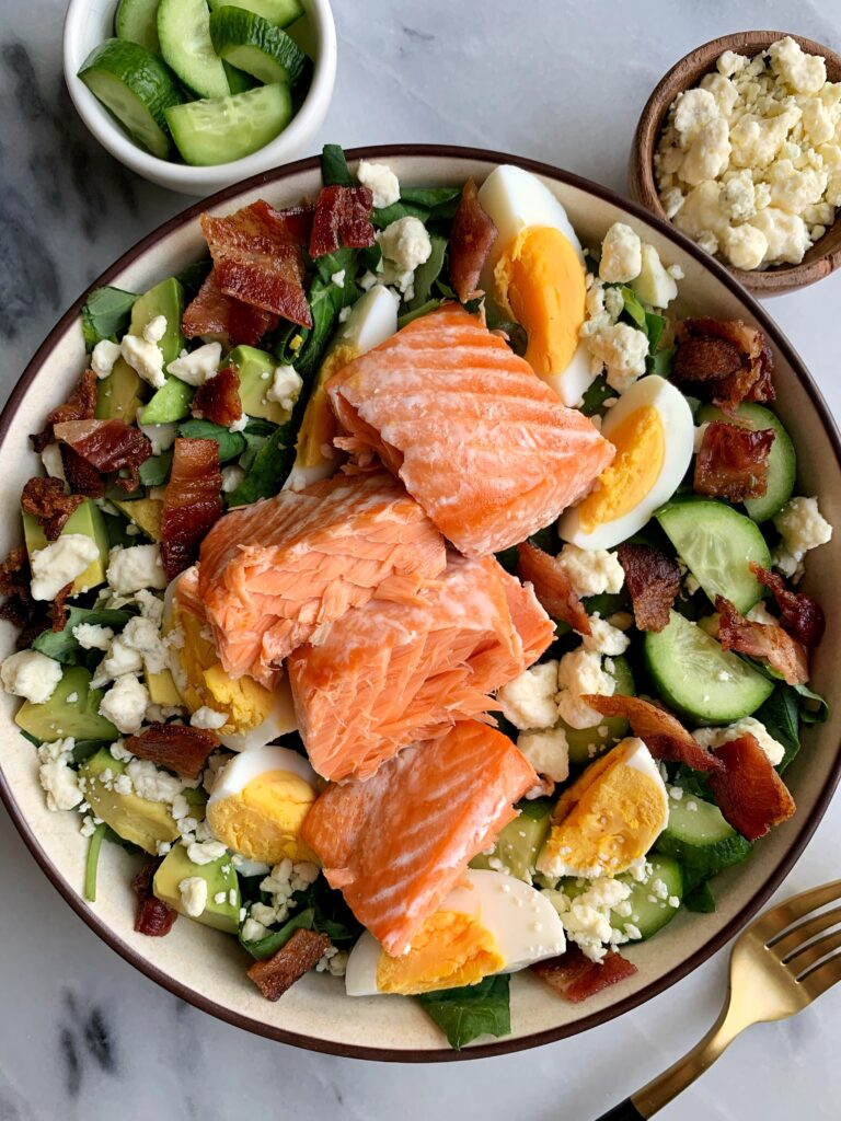 A Delicious Salmon Cobb Salad for a twist on the classic cobb salad recipe. One of our favorite go-to salads to make and pair with any dressing you're are craving!