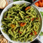 Vegan Cashew Kale Pesto Pasta made with all gluten-free and dairy-free ingredients. This easy pesto pairs perfectly with your favorite pasta and with some delicious roasted tomatoes mixed in for a dreamy vegan dish!