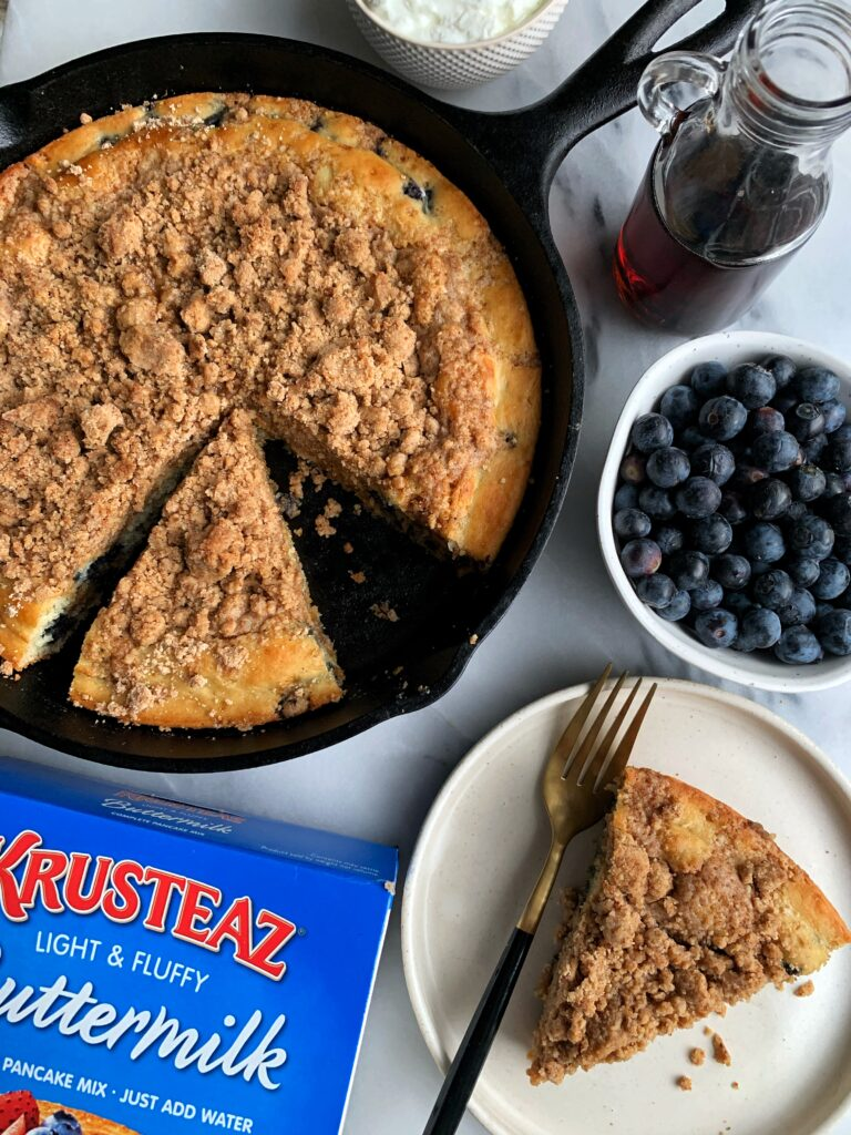 INSANE Blueberry Crumb Cake Pancake Skillet! Blueberry pancake cake made with a family classic pancake mix + topped with a delicious crumb topping ready in 25 minutes.
