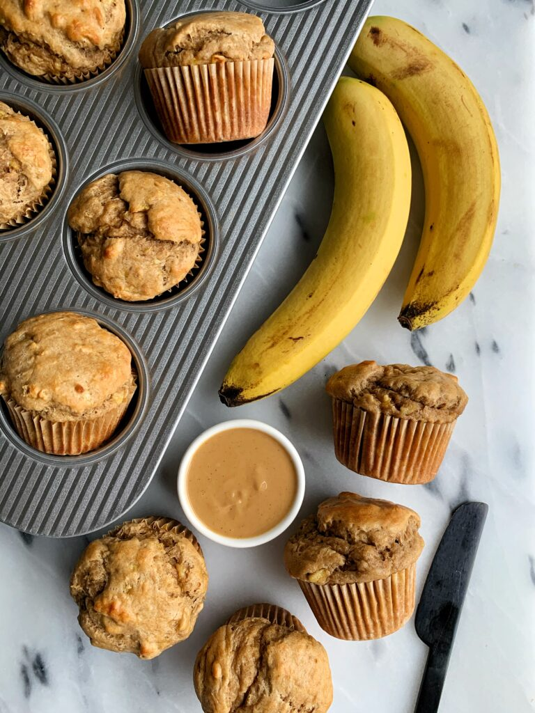 Healthy Peanut Butter Banana Muffins made with all gluten-free and dairy-free ingredients. Plus these have no added sugar - only sweetened with mashed banana!