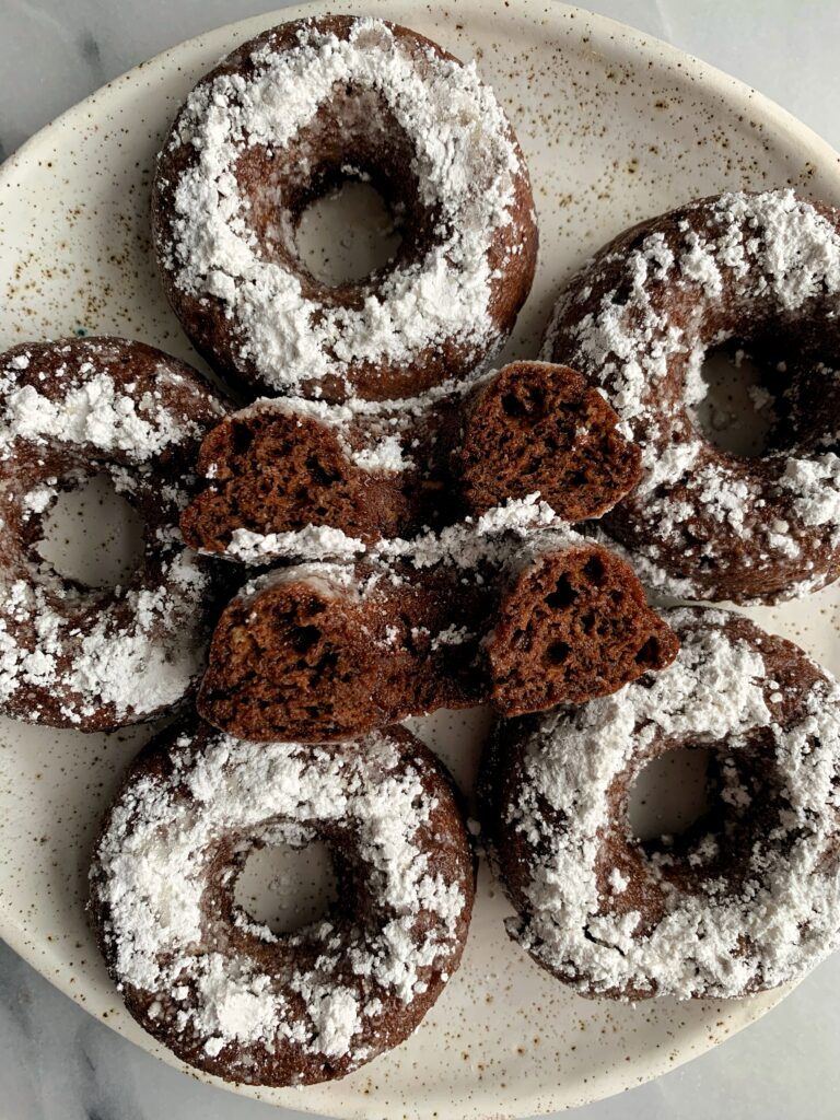 Insanely Good Vegan Chocolate Cake Donuts made with all gluten-free and nut-free ingredients. Plus these oven-baked donuts are ready in less than 15 minutes.