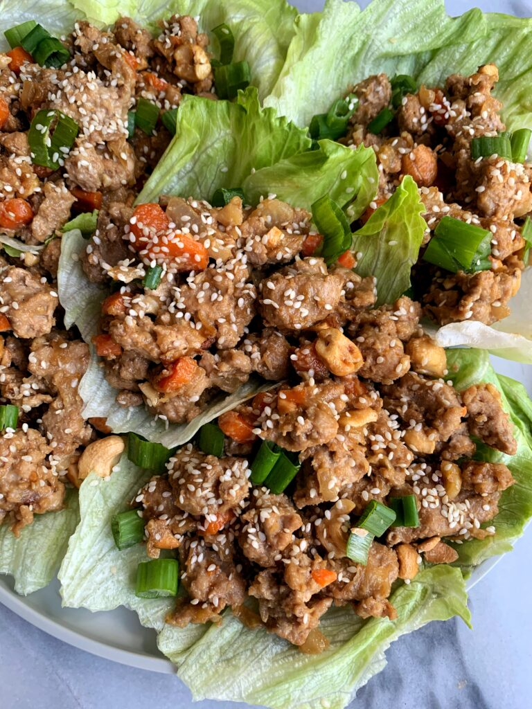 Healthy and flipping delicious Cashew Chicken Lettuce Cups! A twist on the PF Chang's classic lettuce wraps made with all gluten-free, Whole30 and paleo ingredients.