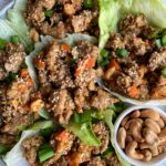 Healthy Cashew Chicken Lettuce Cups! A twist on the PF Chang's classic lettuce wraps made with all gluten-free and Whole30 ingredients.
