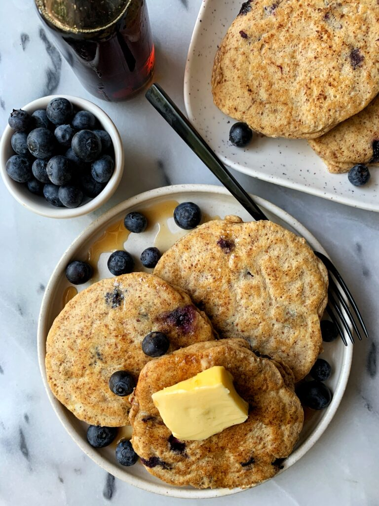 The Absolute BEST Paleo Blueberry Pancakes made with only a few ingredients. This healthy gluten-free pancake recipe is seriously a game changer and takes only 10 minutes to whip up.
