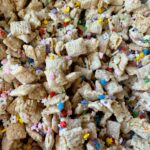 INSANE Funfetti Puppy Chow Recipe! Made with all gluten-free and vegan-friendly ingredients. This is a delicious spin on your favorite puppy chow recipe.