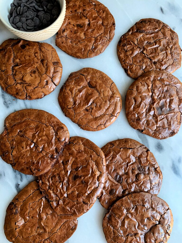 Fudgy Perfect Mudslide Cookies made with all gluten-free and dairy-free ingredients. These flourless cookies are the most delicious crinkle cookie that was inspired by the oh so popular mudslide cocktail (or mocktail!).