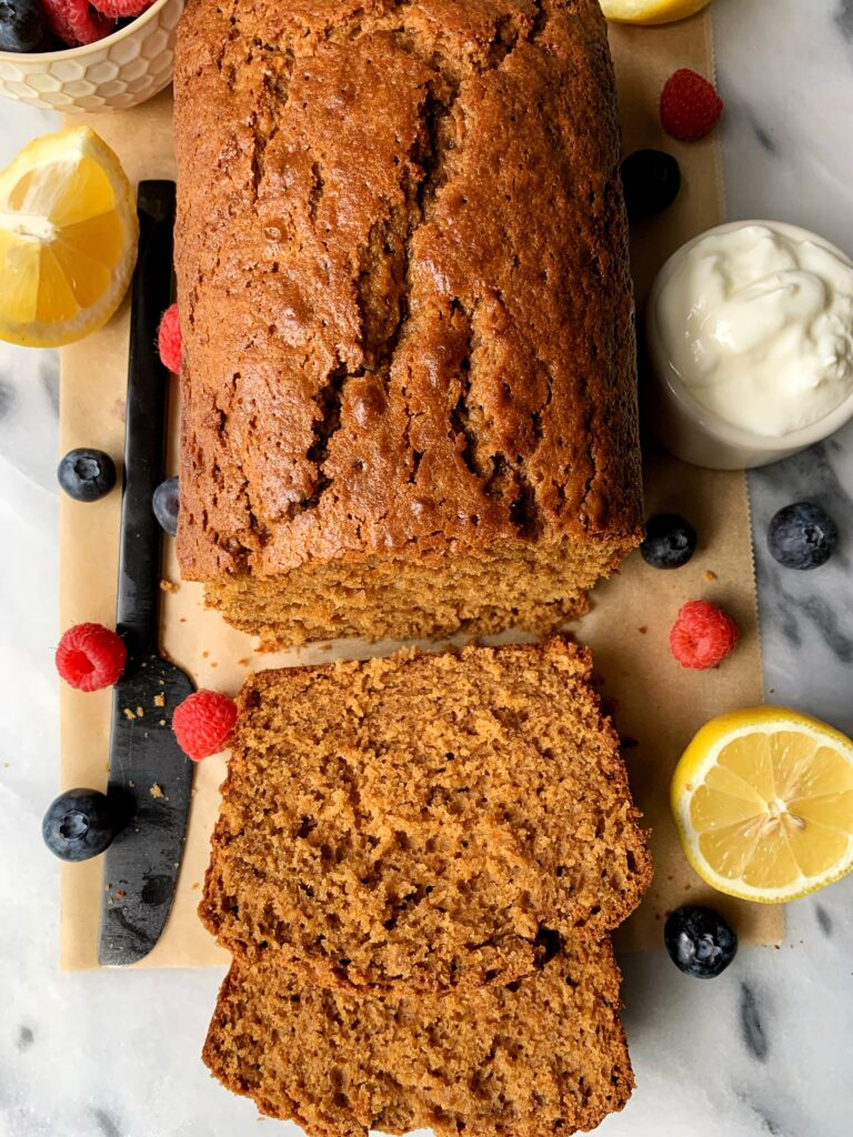This Gluten-free Lemon Olive Oil Pound Cake is just the recipe to bake! Made with just a few simple and healthy ingredients, this golden loaf is just the right amount of sweetness and has a cakey inside with a little crunch on the edges.