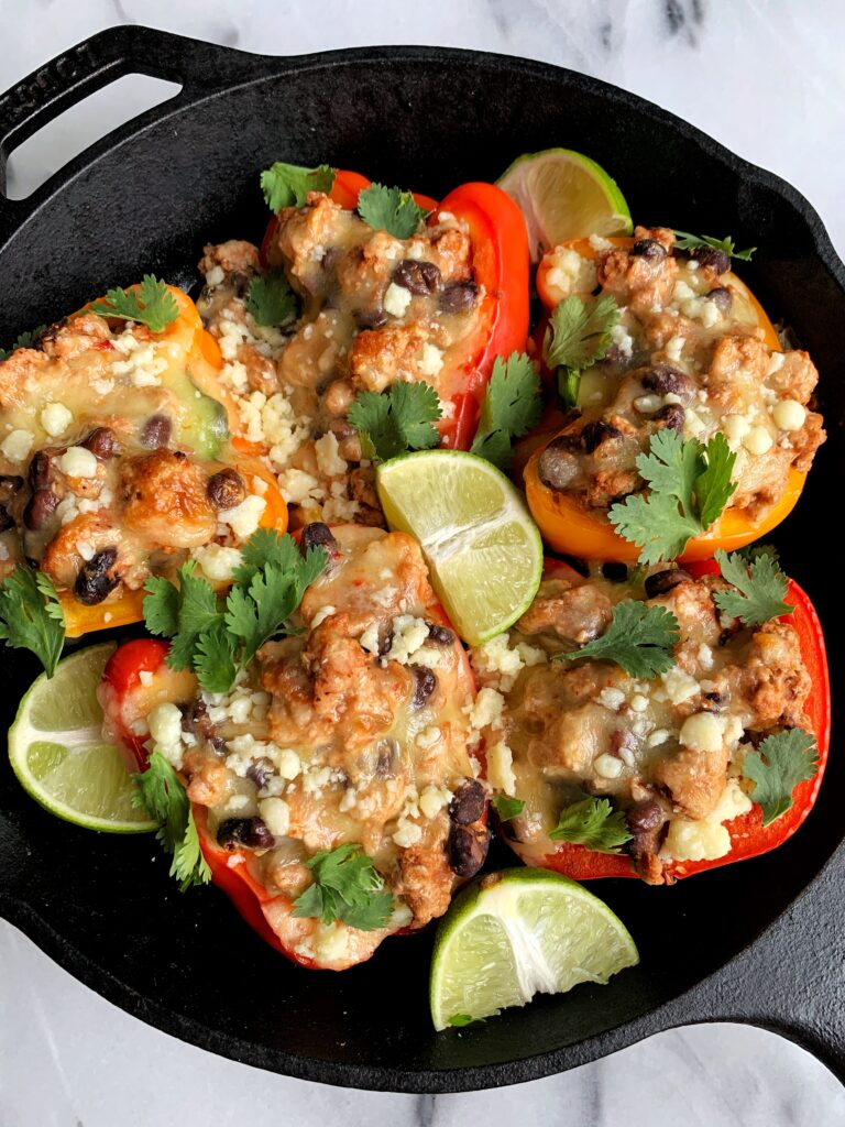 Sharing these easy and healthy Taco Stuffed Peppers! A delicious dinner recipe that is made with all gluten-free and grain-free ingredients. Plus it only takes 20 minutes to whip up for an easy weeknight meal.