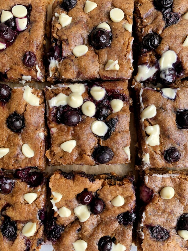 These Gluten-free Blueberry White Chocolate Chip Blondies are an easy and delicious and extra fudgey EPIC blondie recipe to make! Plus they are vegan, nut-free and ready in 25 minutes.