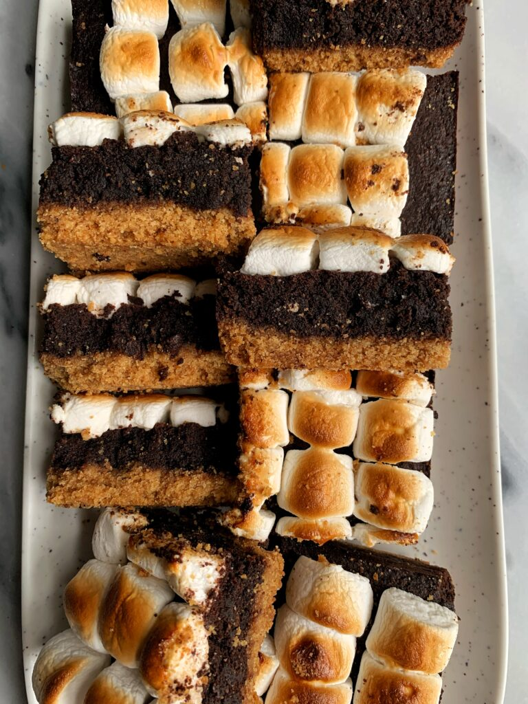 The Absolute Best S'MORES BROWNIE BARS! These s'mores bars are epic filled with a graham cracker base, brownie center and marshmallows on top. And they happen to be gluten-free and you only need a few ingredients to whip them up.