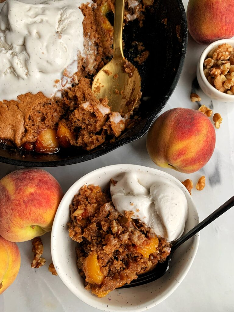 The Best Vegan Gluten-free Peach Cobbler made with just a few simple ingredients. This cobbler is insanely delicious, easy to make and is the ultimate healthy peach cobbler to pair with a scoop of ice cream.