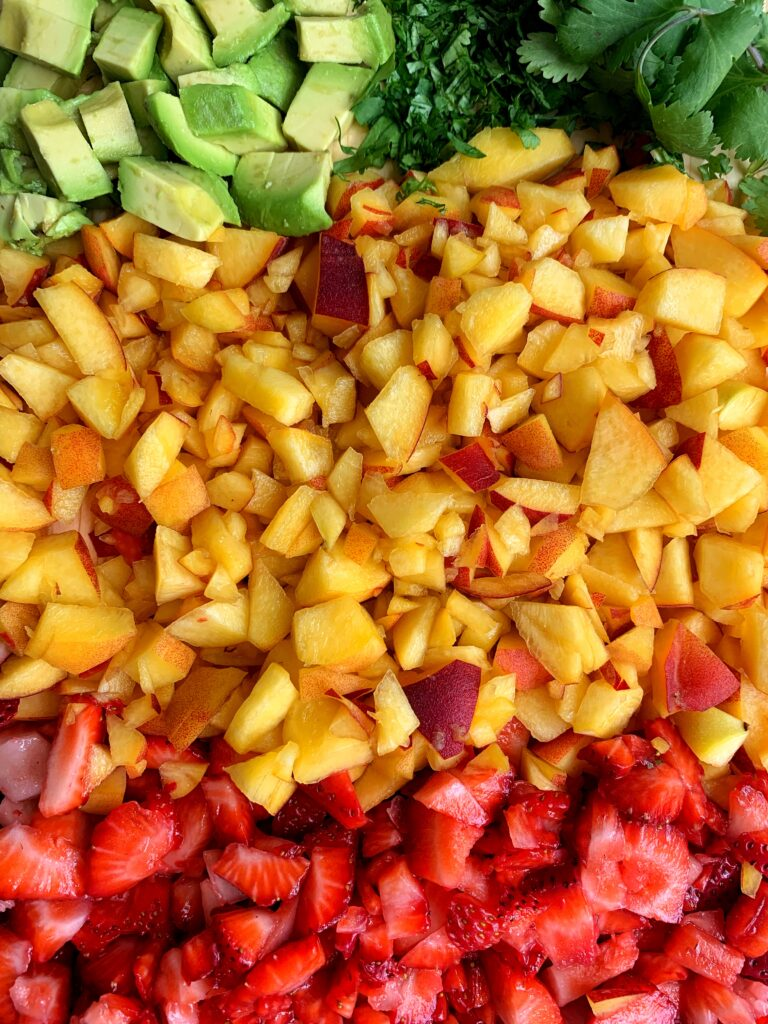 Dreamy Peach Strawberry Avocado Salsa made with only 5 ingredients and takes 10 minutes to make. Breakout your favorite chips and enjoy your new favorite (no onion) summery healthy salsa!