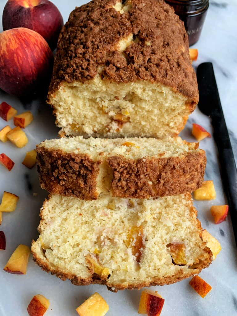 Delicious Peach Crumb Pancake Bread made with my favorite pancake mix and topped with a pancake crumb cake topping and filled with fresh peaches for a perfect peach season recipe.