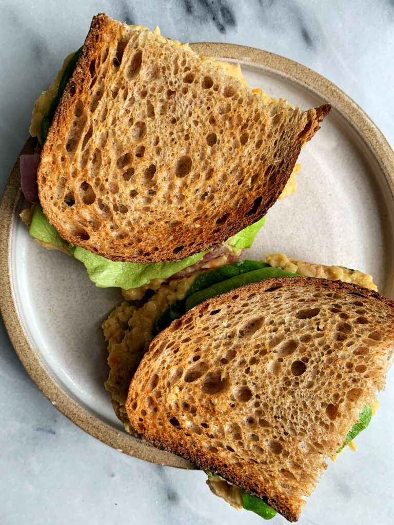 The absolute best vegan Chickpea Salad Sandwich! This is such an easy and delicious plant-based recipe to make for lunch or dinner and it comes together in 5 minutes.